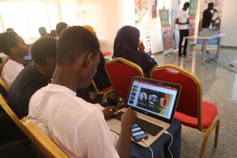 Young man using the online platform for information sharing on Covid-19