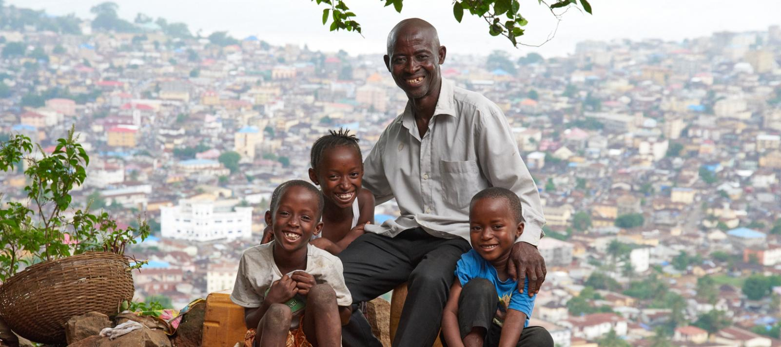 Sulaiman Samura with three of his children, from left, Fatmata, 10 years old, Kabba, 7 years old and Jonathan, 5 years old in the the suburb of Hilltop, Freetown, Sierra Leone on May 30, 2017.