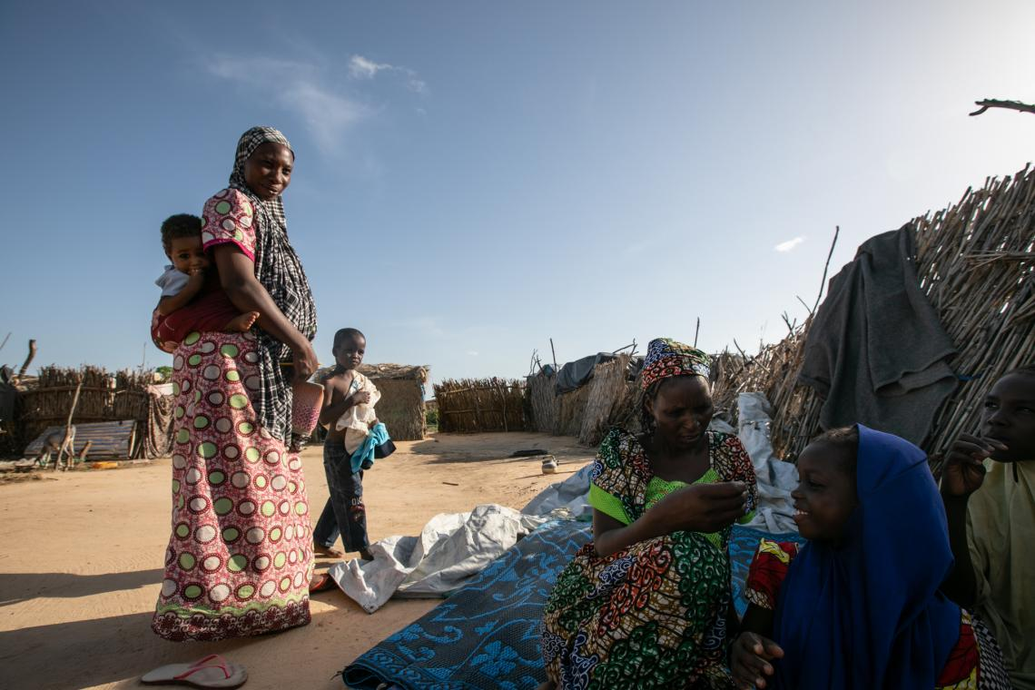 Neighbours and refugee families often stop to visit Hadjara as part of their daily routine.