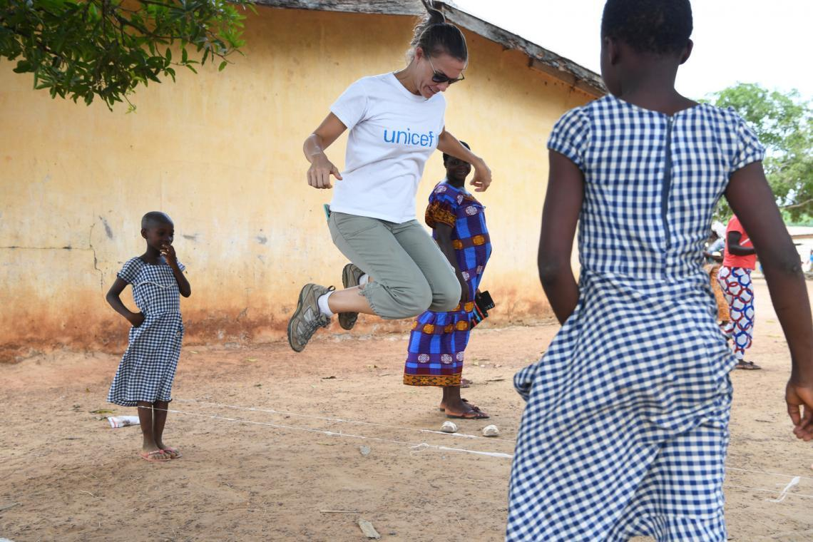 Unicef's Chief of communication, Sophie Chavanel is playing with children outside the school in the village of Kako in the South West of Côte d'Ivoire.