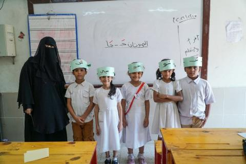 Kefah Abdullah Jaber, 30, uses entertaining exercises to teach reading to primary school students in Aden, Yemen