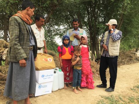 Yemeni family receiving  humanitarian aid