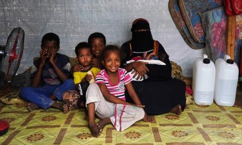 Attikah with her five children under the tent where they live in Khalid Bin Waleed collective centre in Aden.