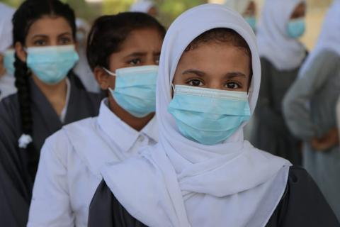 First day of school in Yemen with students wearing masks supported by UNICEF