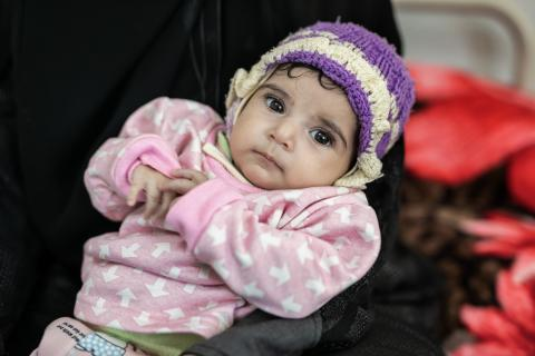 A malnourished child receives care in Yemen