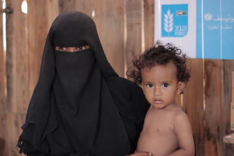 Nabila Idan, 36, with her 1-year-old son, Bashar Taher, who suffers from malnutrition
