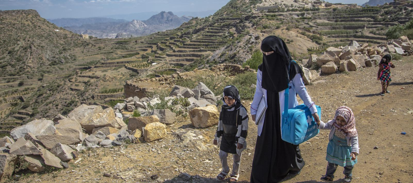 A community health worker conducting household visits in villages around Sana'a.