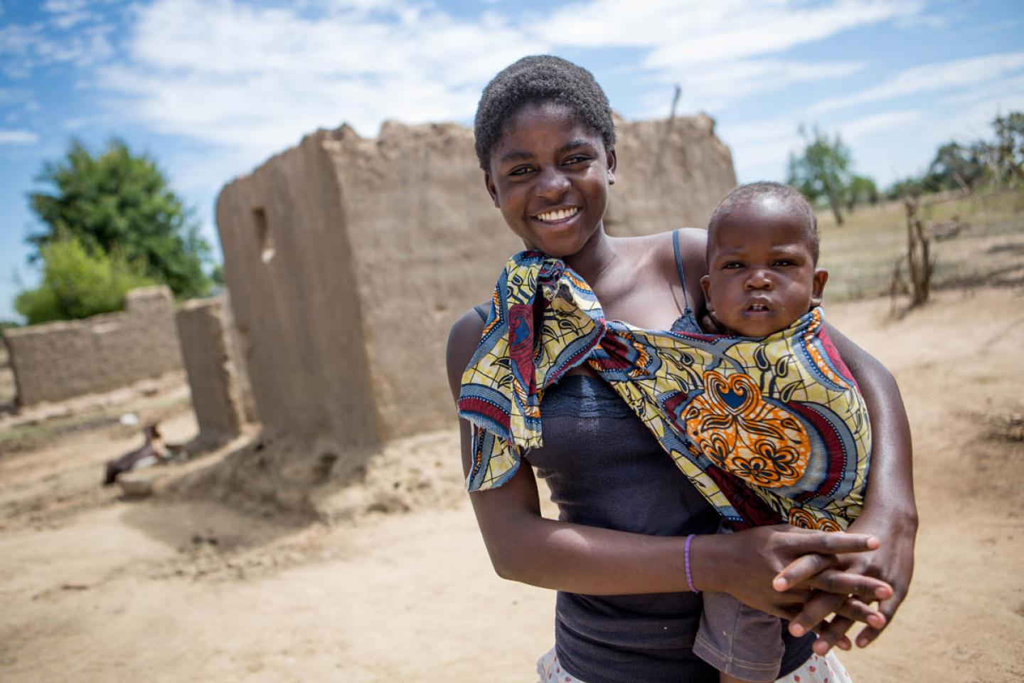 A mother carrying her child in rural Zambia