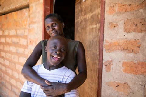 Mother and son hug in Zambia