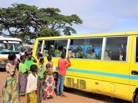Refugees board a bus to travel to a resettlement site in northern Zambia.