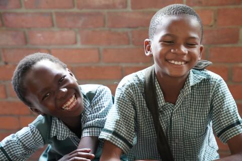 Two smiling boys at school in Zambia