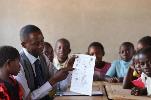 Teacher points to data chart in Zambia