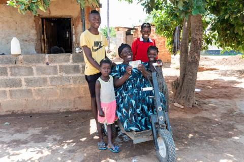 A beneficiary of the COVID-19 ECT with family in Zambia