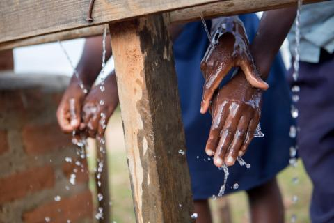 Students wash their hands at a newly built handwashing point at the primary school