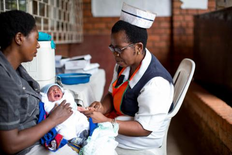 A nurse administers a pentavalent vaccine to an infant