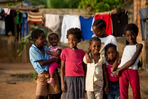 Group of young children in Zambia in front of washing line