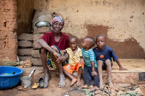 A grandmother and grandchildren outside  their home in Ndola, Zambia