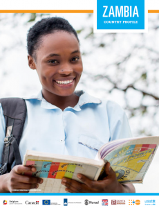 Smiling school girl with text book in hand