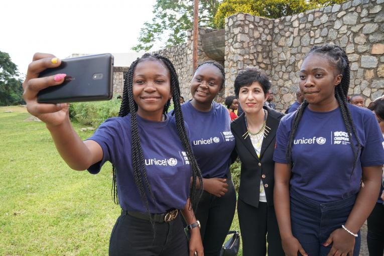 UNICEF Regional Director, Ms. Leila Pakala, with adolescents taking a selfie