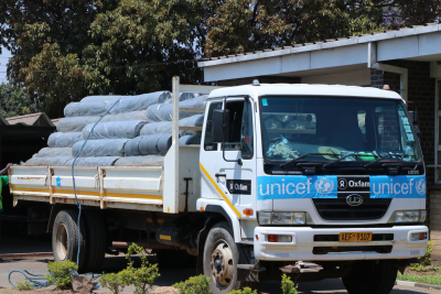 UNICEF truck carrying water containers Supplies.