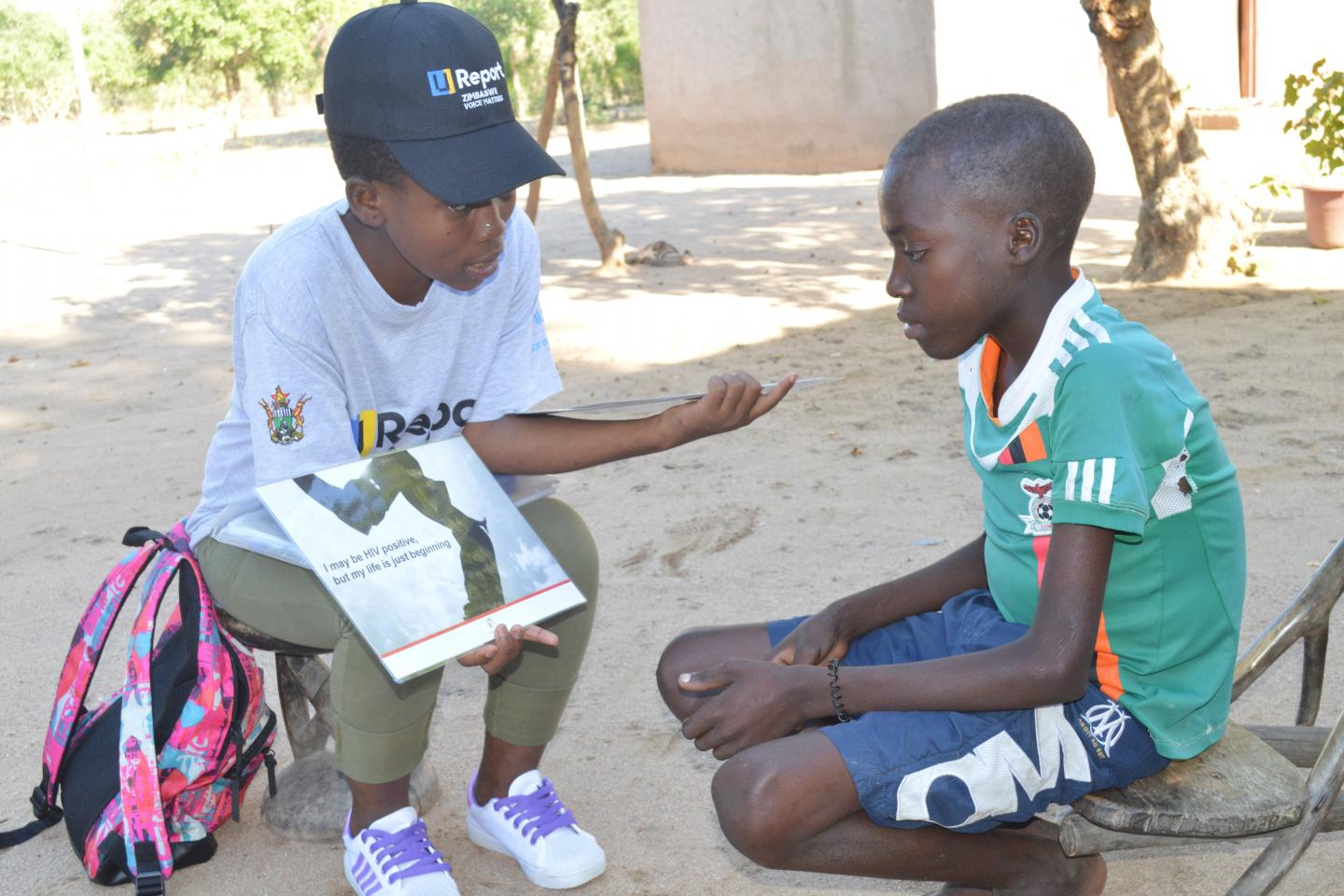 Community Adolescent Treatment Supporter (CATS), Farai* going through counselling routines with Discovery, 17