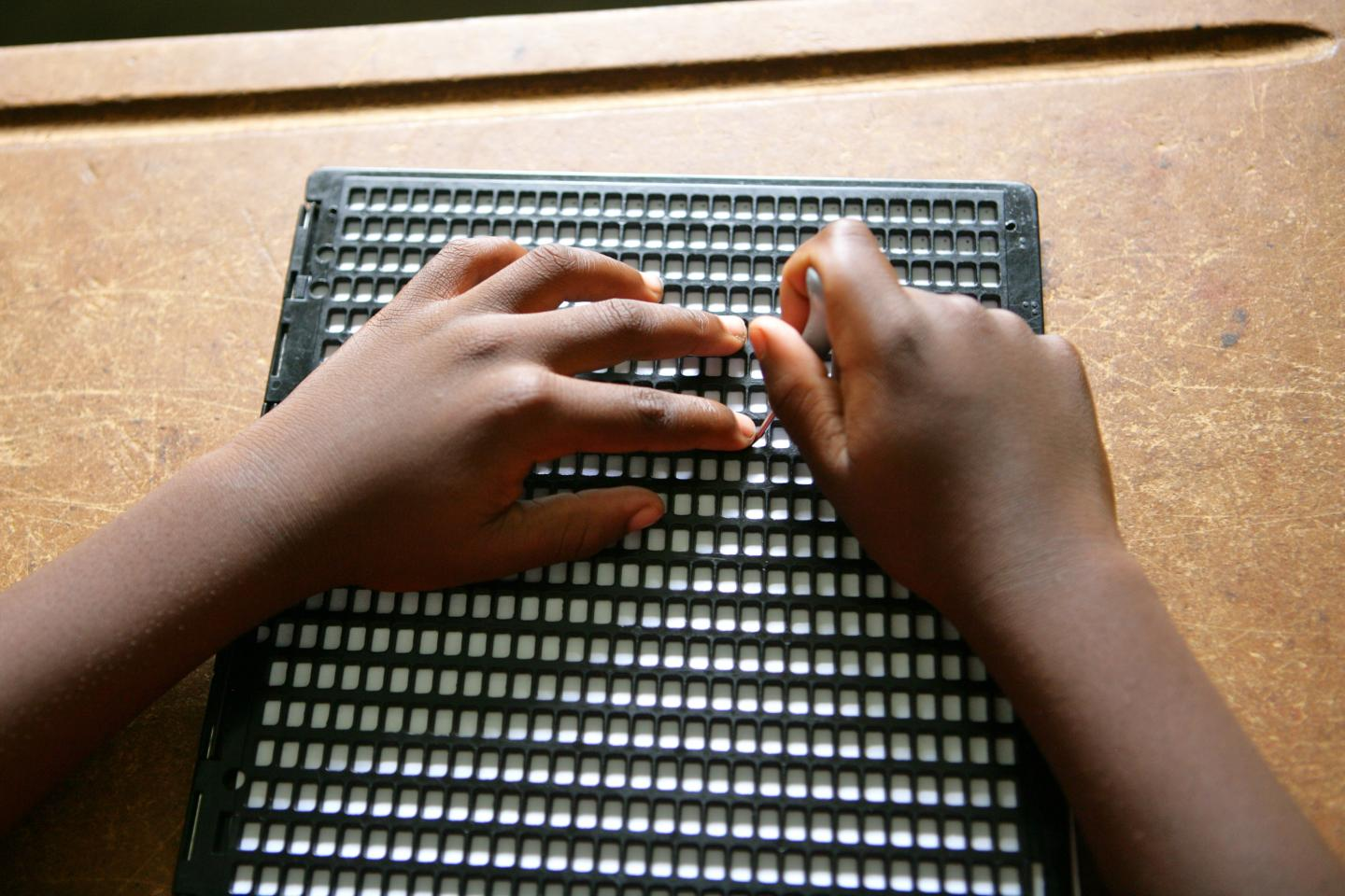 Child reading braille