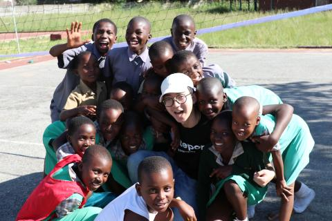 Wei Kia with children at Glen View Community Centre, Harare.