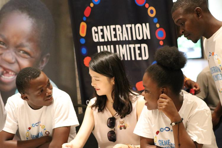 Yulu (centre) meets with young people at the National Youth Indaba in Harare. Charlene (right) has created a school for early married women.