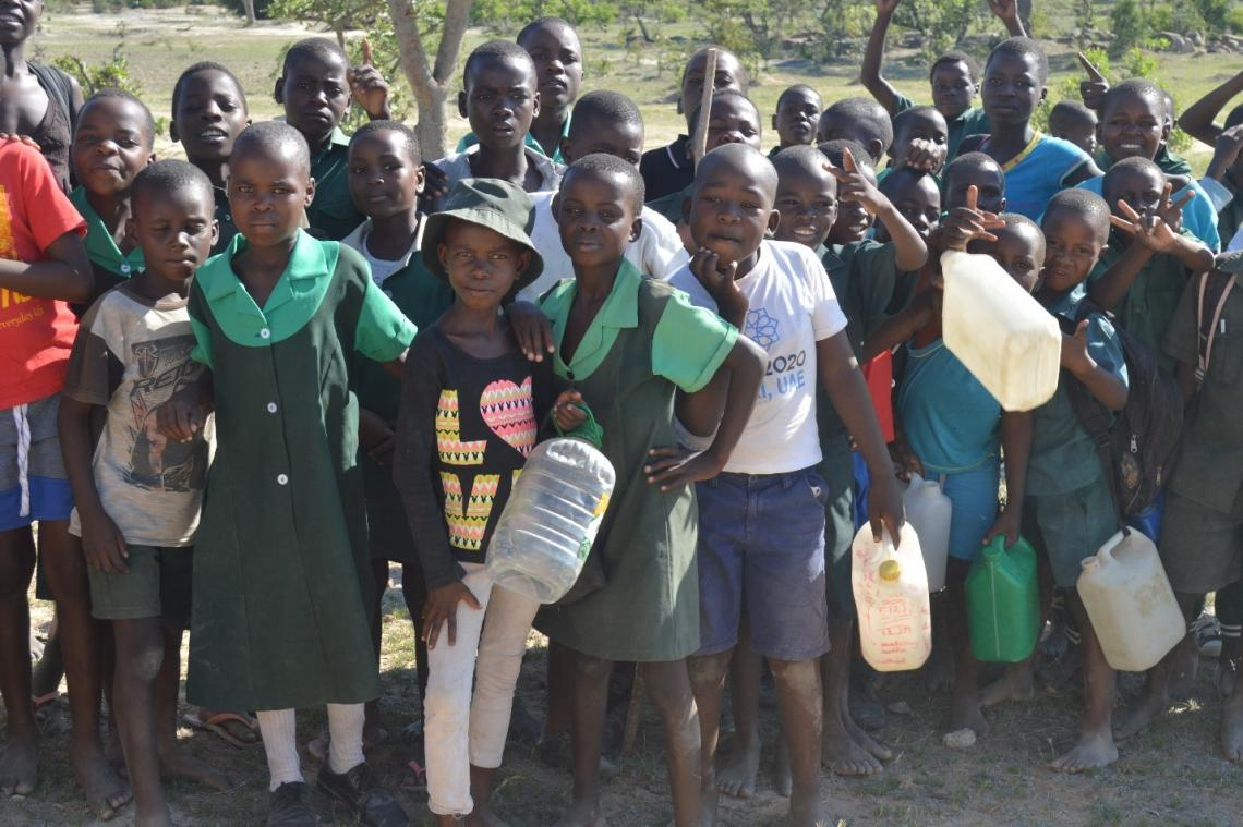 Zeruvi Primary School pupils on their way to fetch water from the new borehole.
