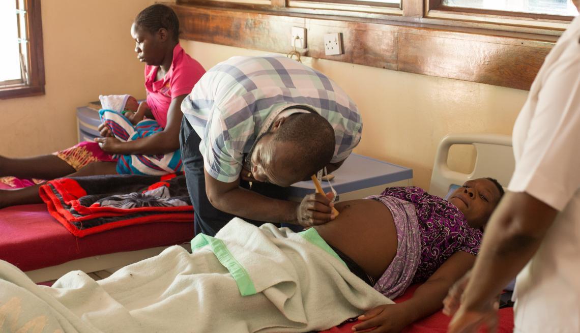 Mentor, Dr. Bob Tariro Murove (left) examining Rudo before her operation.