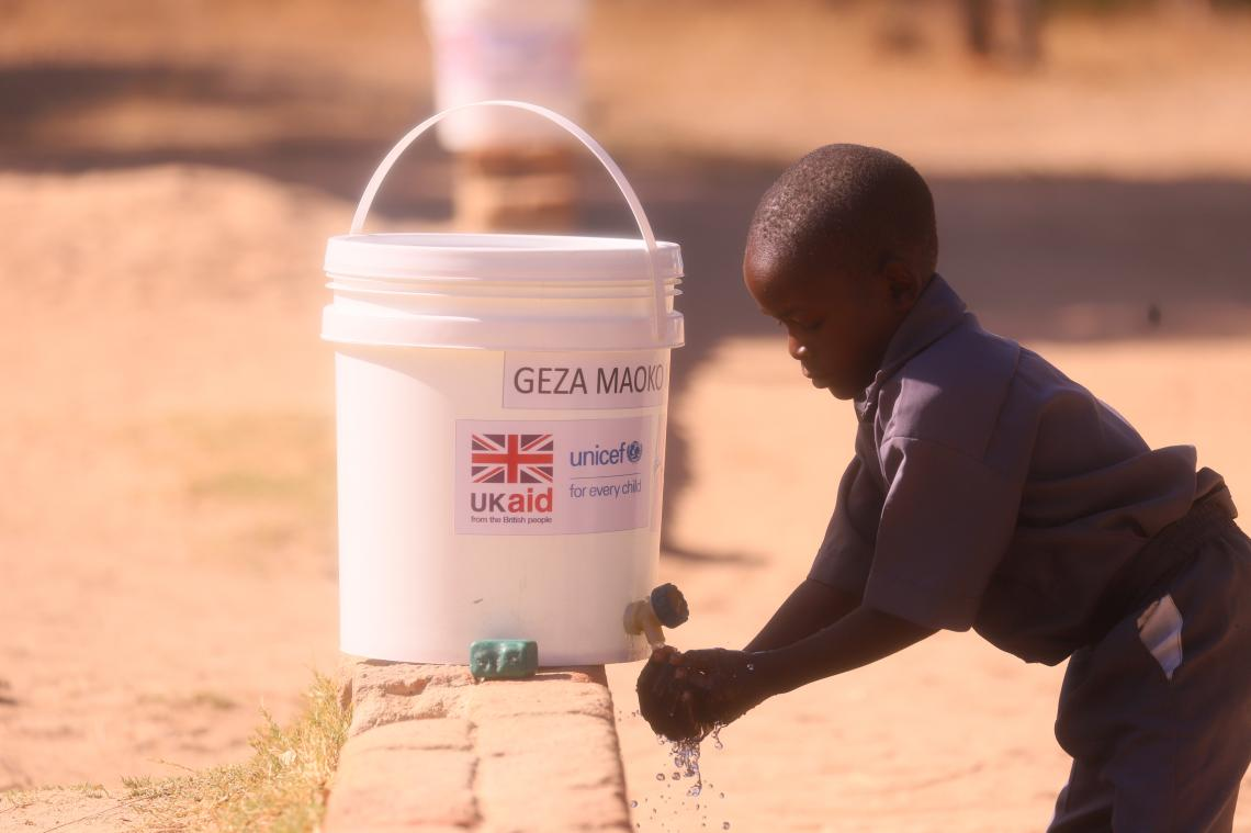 A student from Zedza Primary School in MUtare District washes his hands during a celebration of the Global Handwashing Day.