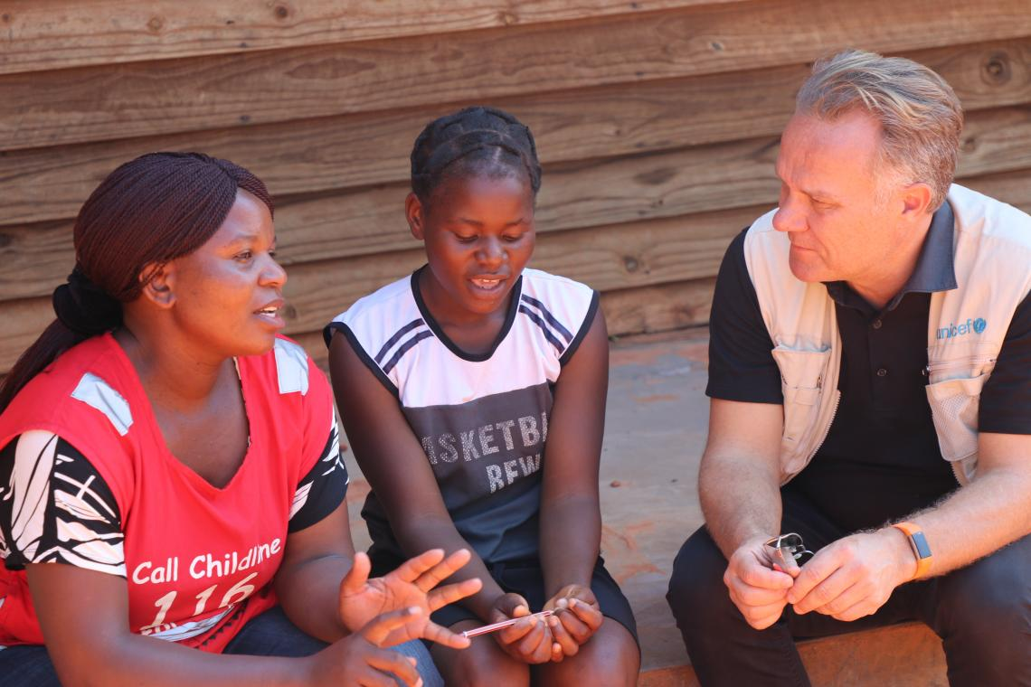 UNICEF Deputy Regional Director,Bo Viktor Nylund spends time with Praise and listens as she retells her harrowing account. Childline Social Worker, Sifelani Dzingi explains some of the psychosocial interventions taking place.