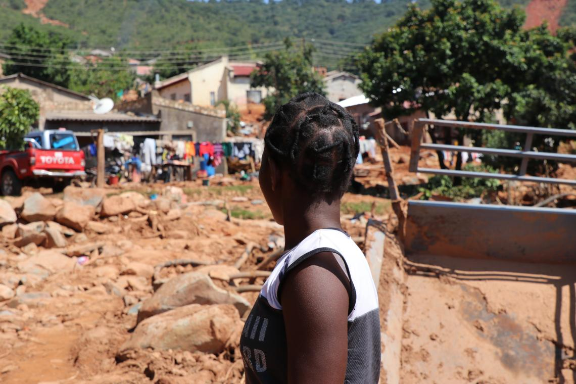 Praise looks at what used to  be her neighbourhood in Ngangu Township. Most houses have been completely buried by the rocks that tumbled down the mountain when Cyclone Idai hit