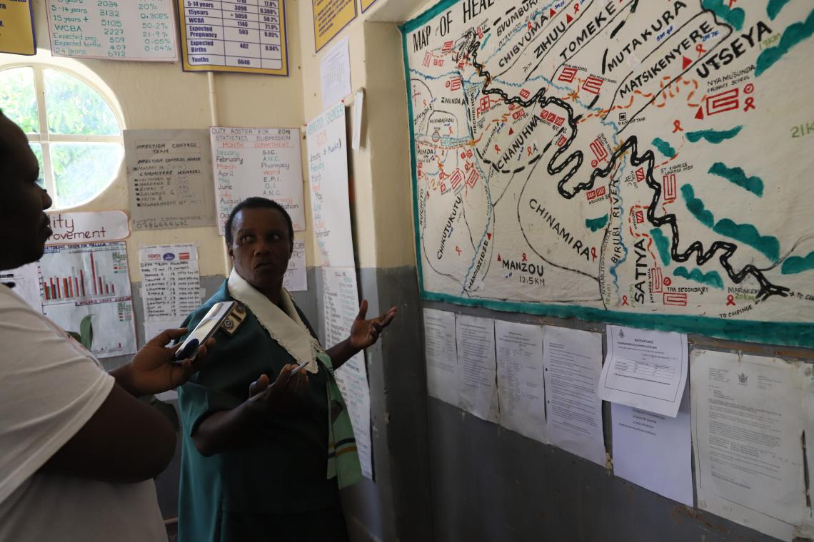 Sister-in-charge of Biriiri Hospital in Chimanimani, Elizabeth Tinofa shows the map of areas that have received awareness campaigns on the importance of immunising against Measles.