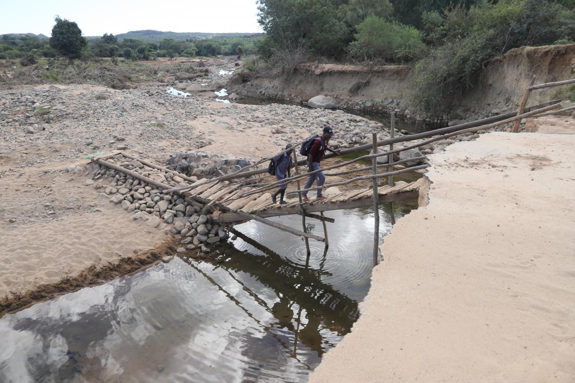 School children cross a makeshift bridge along Chimanimani road. The bridge was washed away during a devastating Cyclone Idai that affected the region.