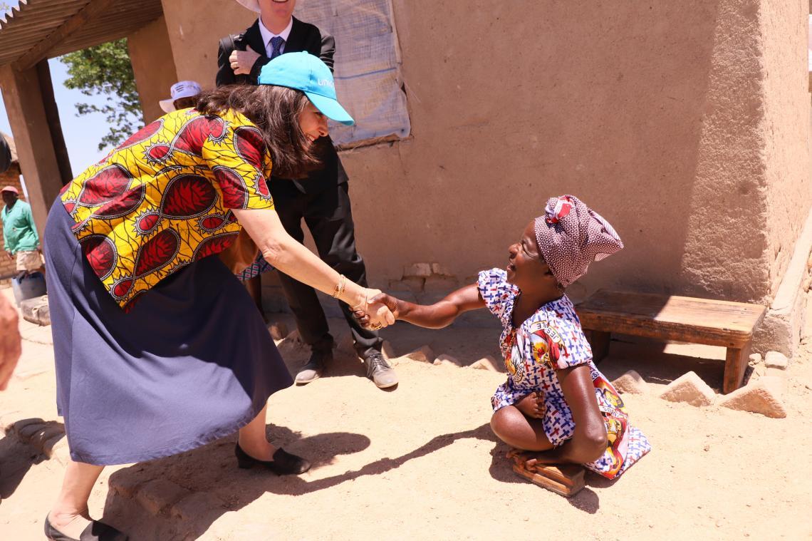 Laylee Moshiri, UNICEF representative meets beneficiary, Maria Mufambanhando during a tour of Mutsago village that was declared Open  defacation Free