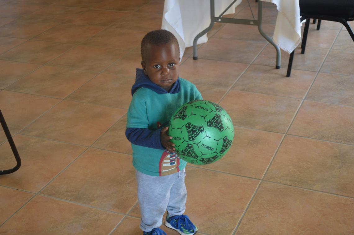 Zelifa Dube's son playing with a ball during the training
